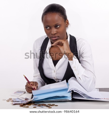 Young woman doing working on a solution for her budget problems. - stock photo