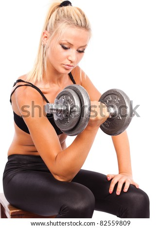 Young woman doing workout with weights, isolated on white background - stock photo