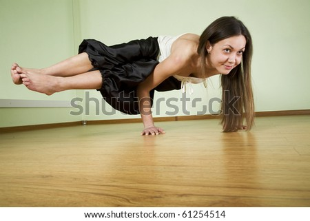 Young woman doing yoga an a floor - stock photo