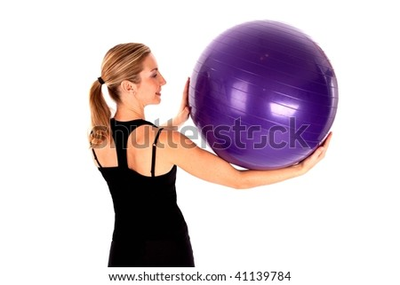 Young woman doing yoga ball exercises isoalted - stock photo