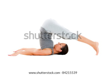 young woman doing yoga exercise. isolated on white background - stock photo
