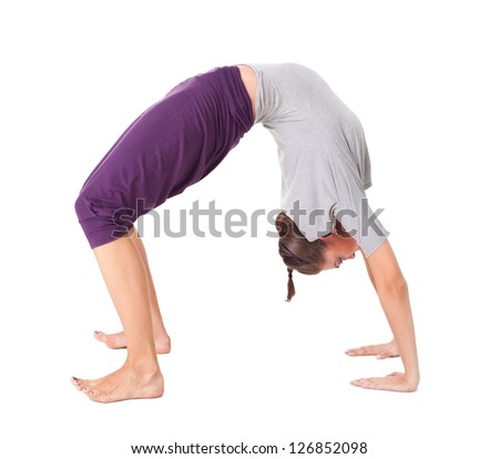 "Young woman doing yoga exercise "" Wheel Pose"". Isolated on white background"