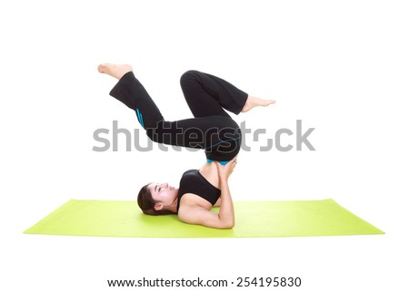Young woman doing yoga exercise with yoga mat isolated on white background - stock photo