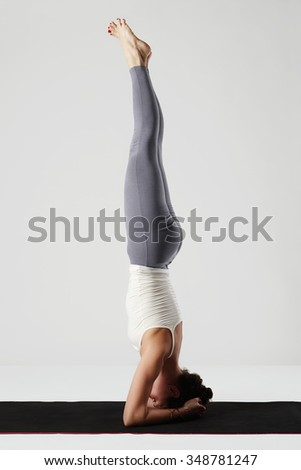 young woman doing yoga exercises.healthy fit girl.stretching
