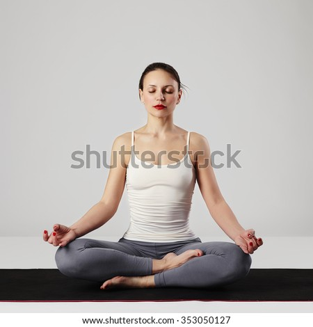 young woman doing yoga exercises.healthy sport girl