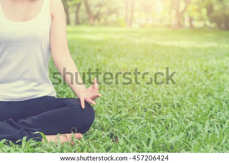 Young woman doing yoga in the park,Close up yoga  relax in nature