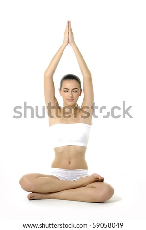 Young woman doing yoga moves or meditating on white - stock photo