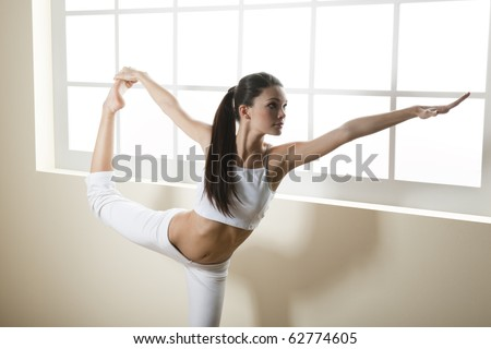 Young woman doing yoga or stretching, arm outstretched - stock photo
