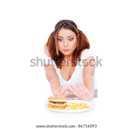 young woman don't want to eat junk food. isolated on white background - stock photo