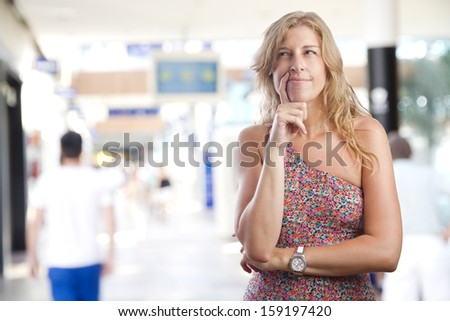 young woman doubting in a shopping center - stock photo