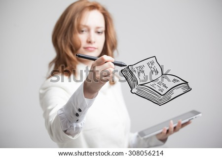 young woman drawing a book - stock photo