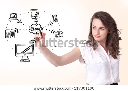 Young woman drawing a cloud computing on white whiteboard - stock photo