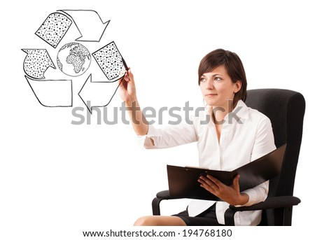 Young woman drawing recycle globe on whiteboard isolated on white - stock photo