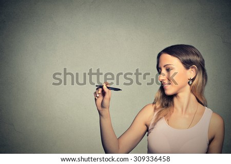 Young woman drawing writing on board with empty copy space - stock photo