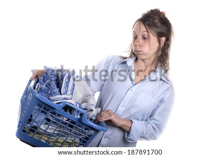 Young woman dreading doing her ironing on white background - stock photo