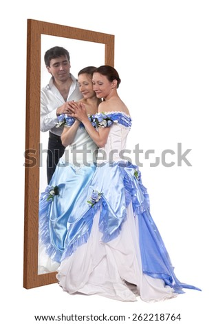 Young woman dreaming about a man near a mirror - stock photo