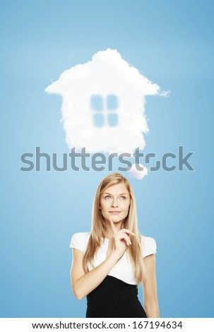 young woman dreaming  of a new house - stock photo
