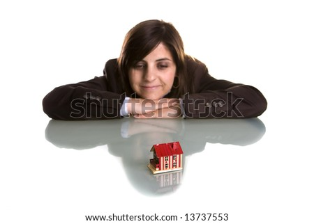 young woman dreaming with new house - real state concept - stock photo