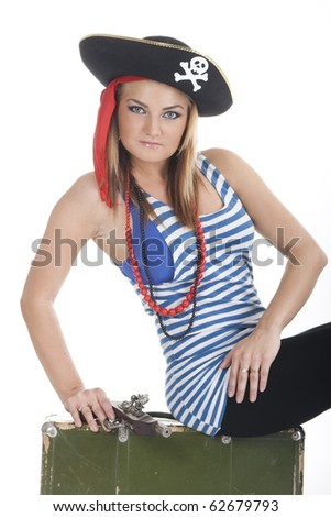 Young woman dressed as a pirate in a black hat holding an old gun