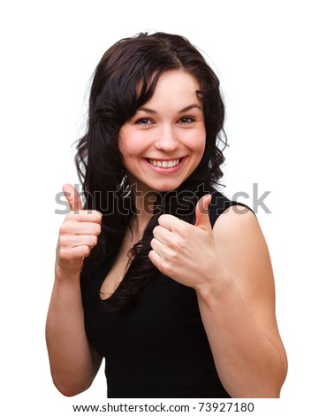 Young woman dressed in black is showing thumb up gesture, isolated over white