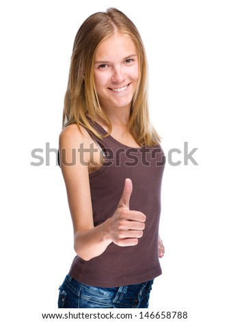 Young woman dressed in blue is showing thumb up gesture, isolated over white - stock photo