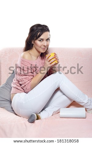 young woman drink coffee and reading a book