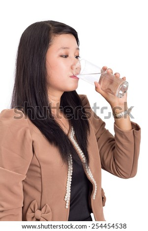 Young woman drinking a glass of fresh water, body hydration concept - stock photo