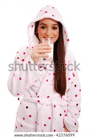 Young woman drinking a glass of milk on white background - stock photo