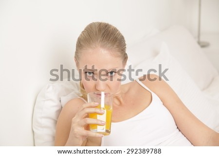 Young woman drinking a juice