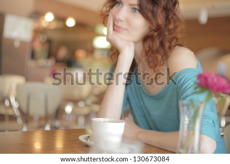 Young woman drinking a tea - stock photo