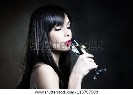 young woman drinking champagne studio shot - stock photo