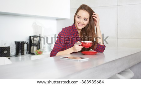 young woman drinking coffee at home in the morning - stock photo