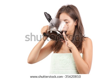 Young woman drinking coffee in the morning, after shower