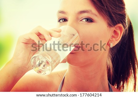 Young woman drinking fresh cold water from glass - stock photo