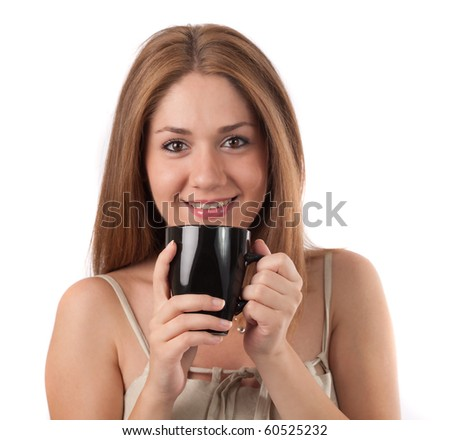 Young woman drinking from a cup,isolated on white