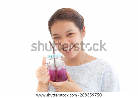 young woman drinking fruit juice, on white background - stock photo