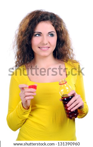 Young woman drinking juice - stock photo