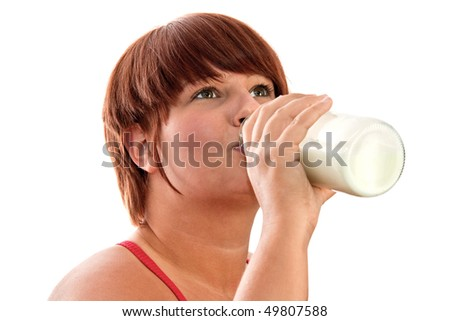Young woman drinking milk - isolated on white background - stock photo