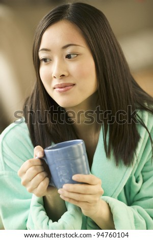 Young woman drinking morning coffee