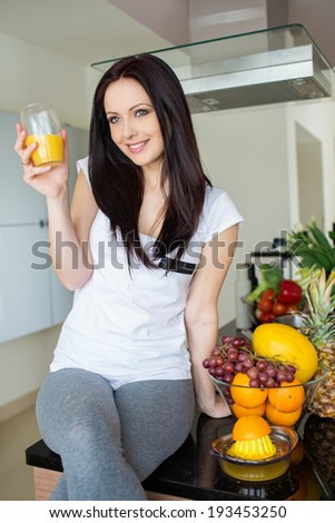 Young woman drinking orange juice - stock photo