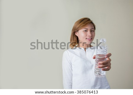 Young woman drinking water look so fresh