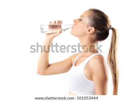 young woman drinking water, on white background - stock photo