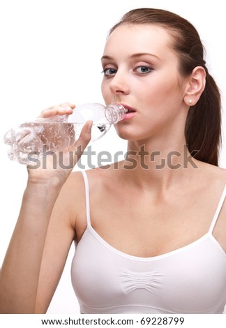 Young woman drinks a water, on a white background.