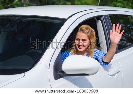 Young woman drive the car - stock photo