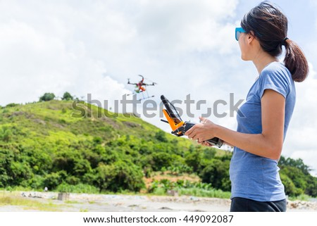Young woman drives drone
