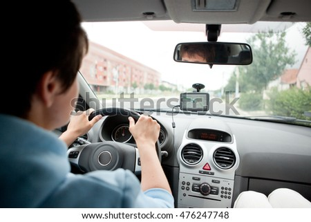 Young Woman Driving a Car in the City