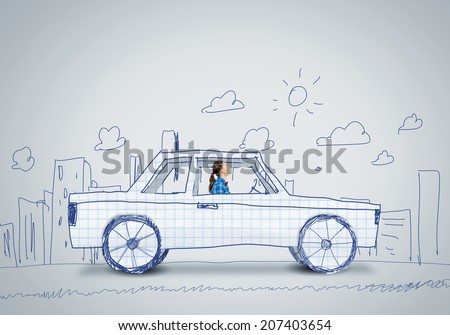 Young woman driving car made of paper - stock photo