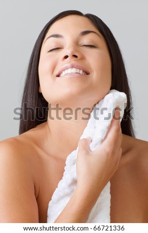 Young woman drying herself off with a towel