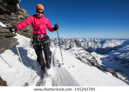 Young woman during winter mountain climb - stock photo