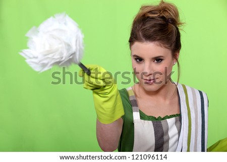 Young woman dusting - stock photo